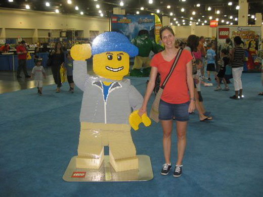 Women holding lego figure's hand