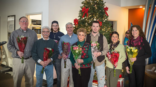 Employees hold flowers