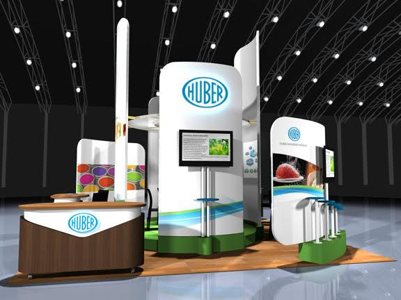 Huber Trade Show Exhibit with tables and TVs