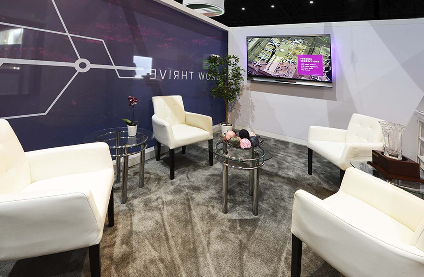 4 white chairs in tradeshow booth