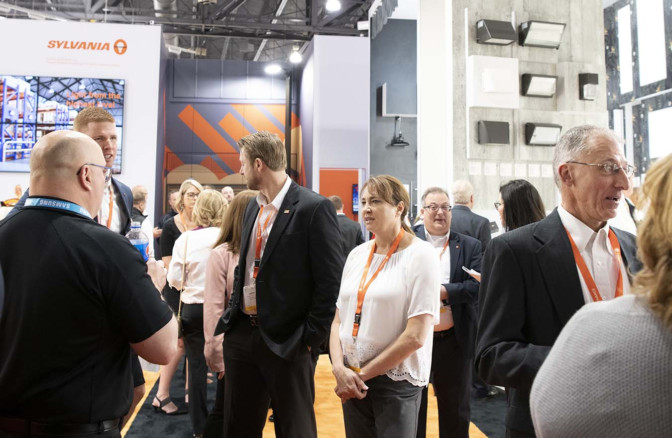 crowd gathers at tradeshow display