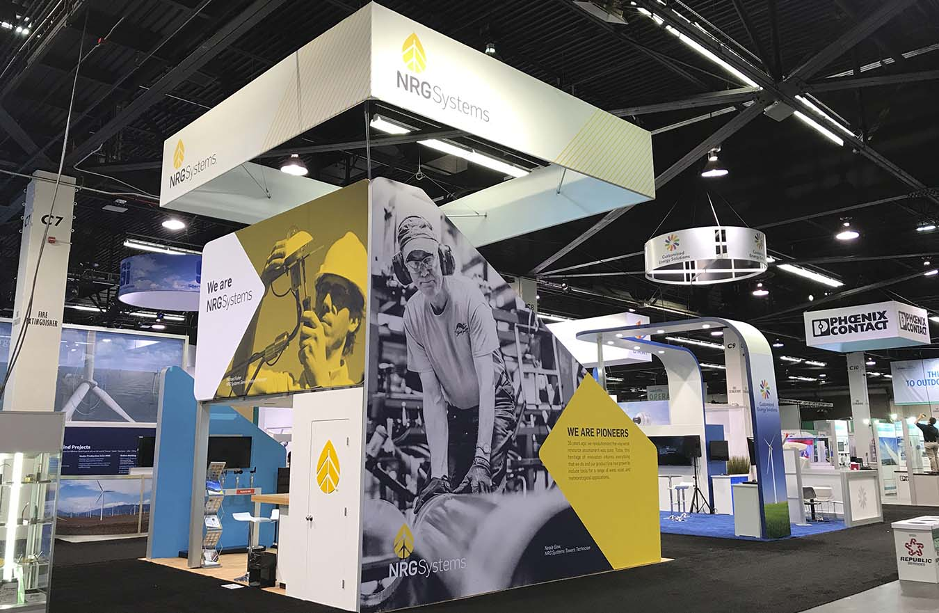2 story trade show display with images on walls