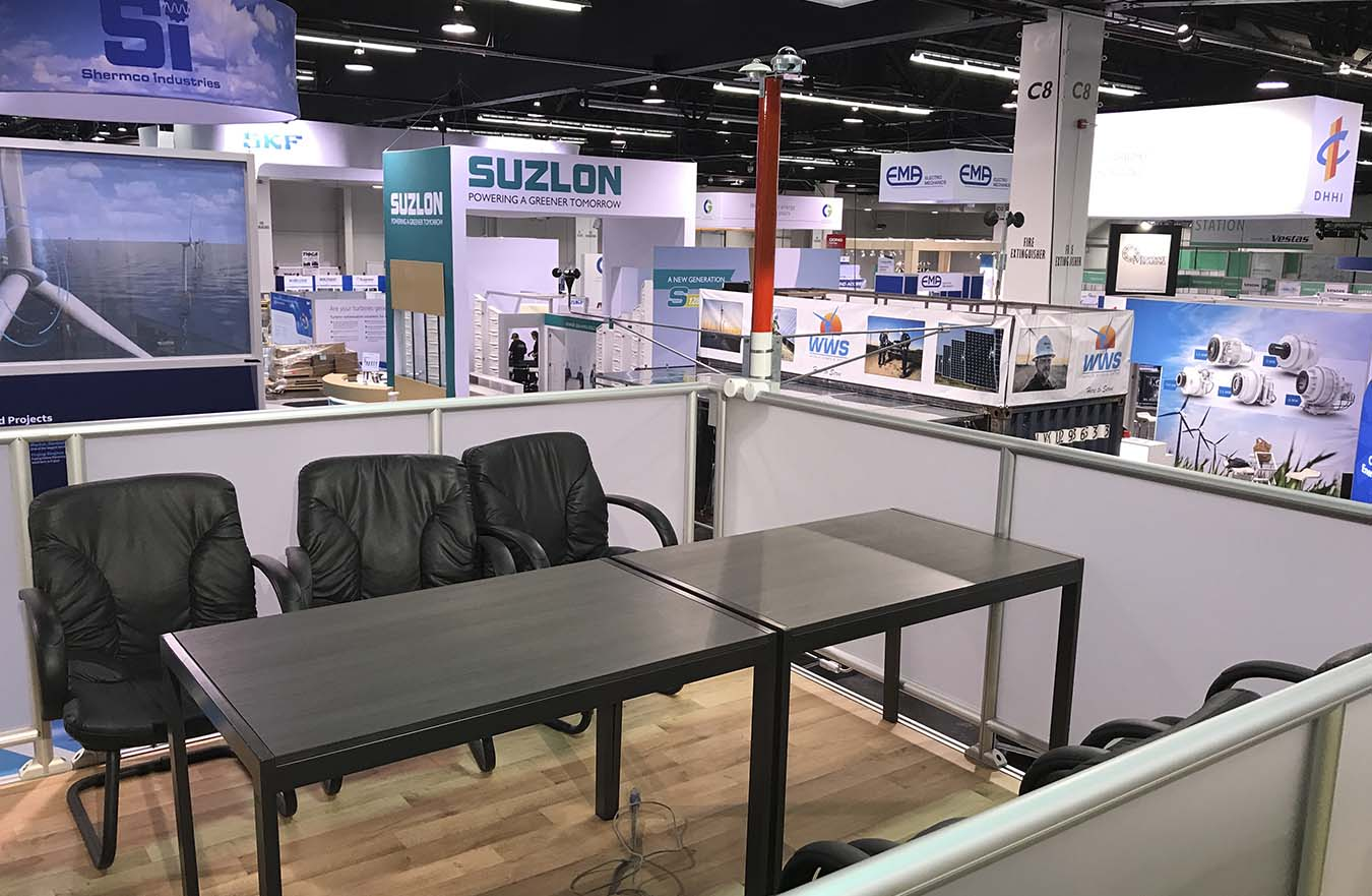 desk and chairs in tradeshow display
