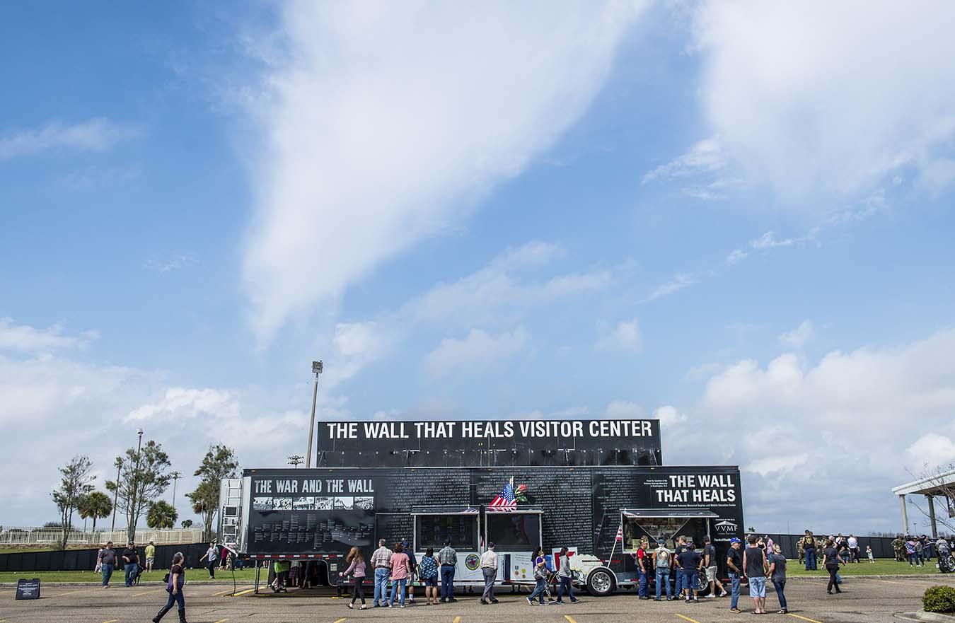 crowd gathered around mobile Vietnam Veterans Memorial
