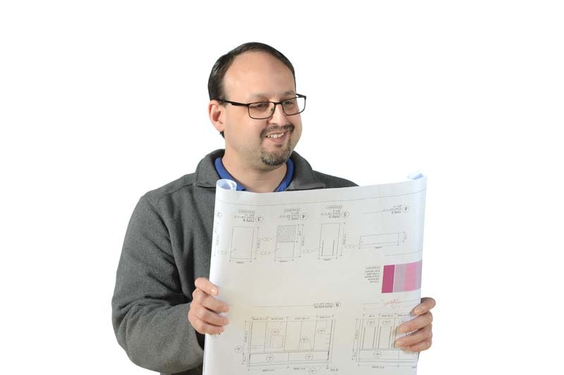 Brandon Verdu Fabrication Engineering Manager reviewing plan