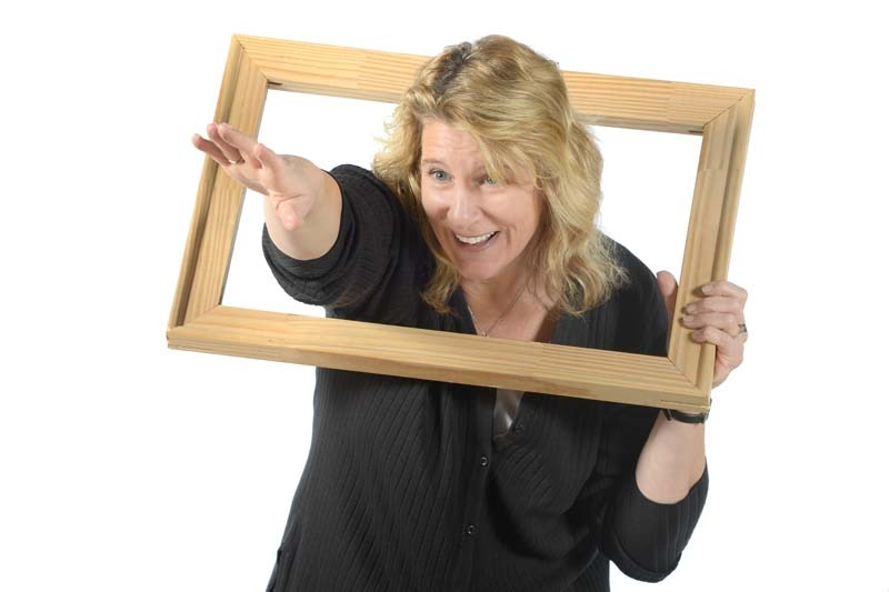 Cathy Miller holding picture frame
