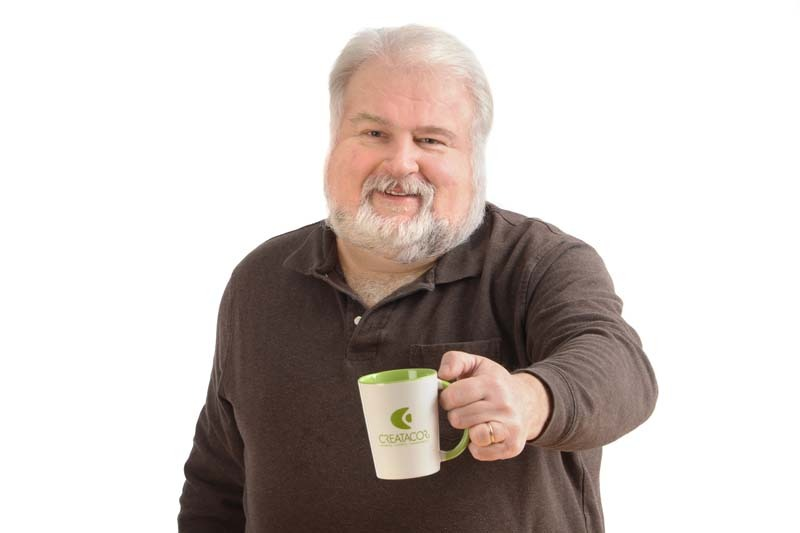 Dave West with mug