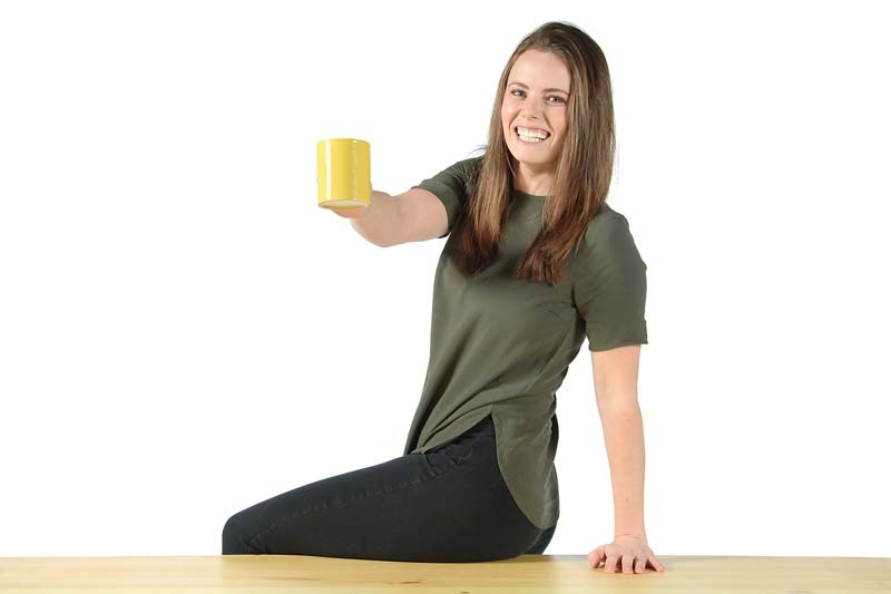 Emma Schlieder holding coffee mug