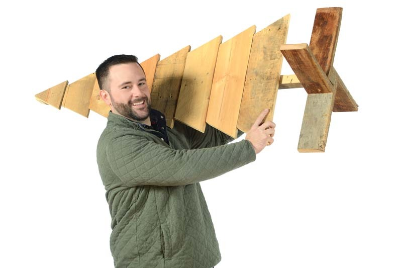 Jason Saunders holding wood tree