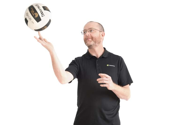 Jimmy Dolan holding volleyball