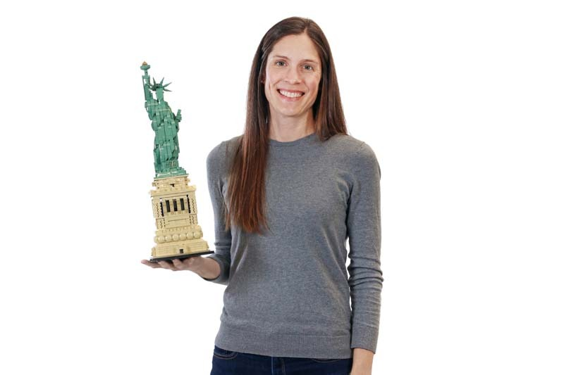 Kim Lathem holding small statue of liberty