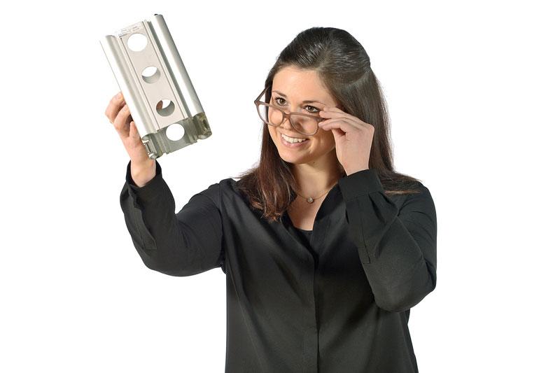 Olivia Privitera holding aluminum block