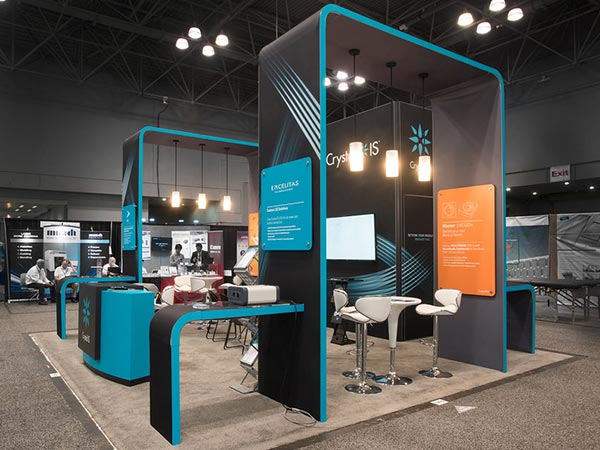 Trade show exhibit with modern round tables