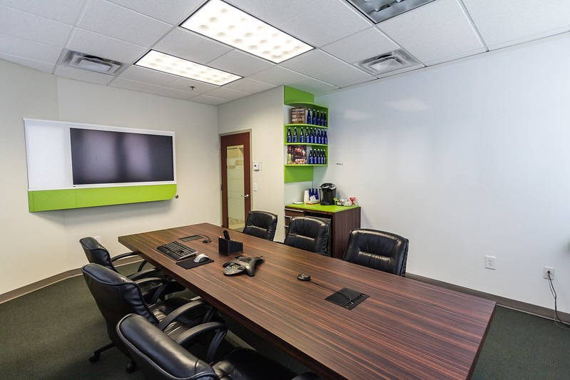 conference room with large table and TV on the wall
