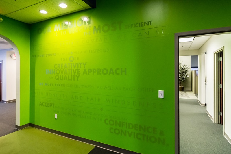 Word cloud on green wall