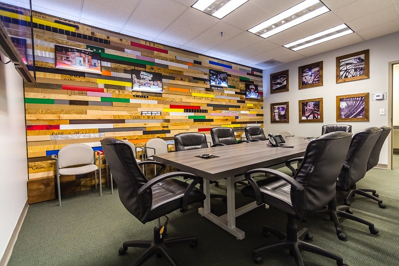 Conference room with colorful wood planked wall
