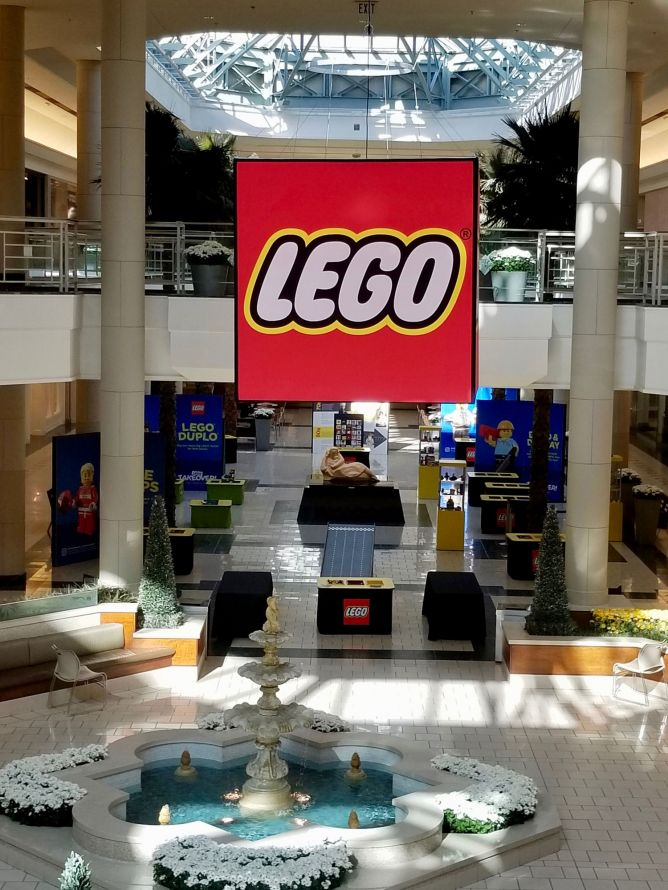 lego banner hanging in a mall