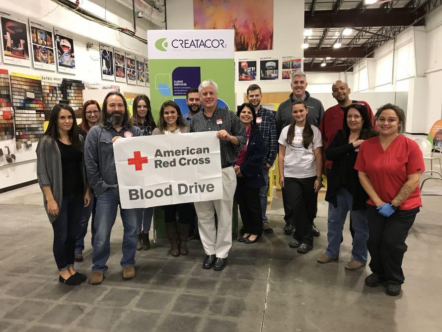 creatacor staff holding american red cross banner