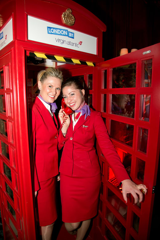 virgin atlantice flight attendants in a red london phone booth